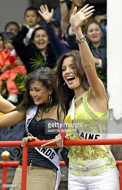 Miss Netherlands Lindsay Pronk and Miss Ukraine Oleksandra Nikolayenko wave at the crowd during a parade in Quito Ecuador 23 May 2004 where the Miss...