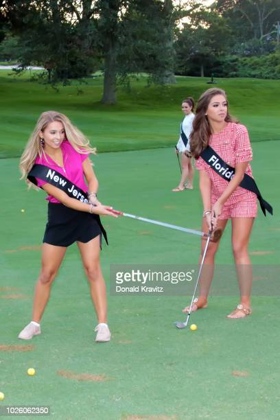 Miss New Jersey 2018 Jamie Gialloreto and Miss Florida 2018 Taylor Tyson practice hitting golf balls on the chipping green during The Miss America...