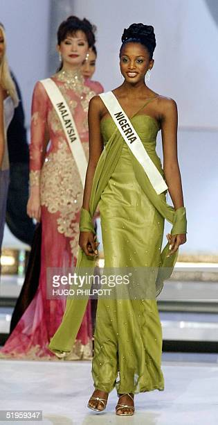 Miss Nigeria Chinenye Ochuba walks on stage after reaching the semifinals 07 December 2002 in the 2002 Miss World contest at the Alexandra Palace in...