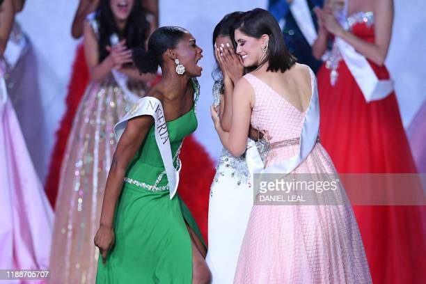 Miss Nigeria Nyekachi Douglas and Miss Brazil Elis Coelho support Miss Jamaica ToniAnn Singh as she is anounced Miss World 2019 during the the Miss...