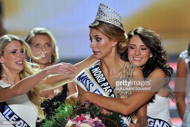 Miss NordPasdeCalais Camille Cerf is congratulated by Miss Ile de France 2014 Margaux Savarit and Miss Auvergne 2014 Morgane Laporte after Cerf won...