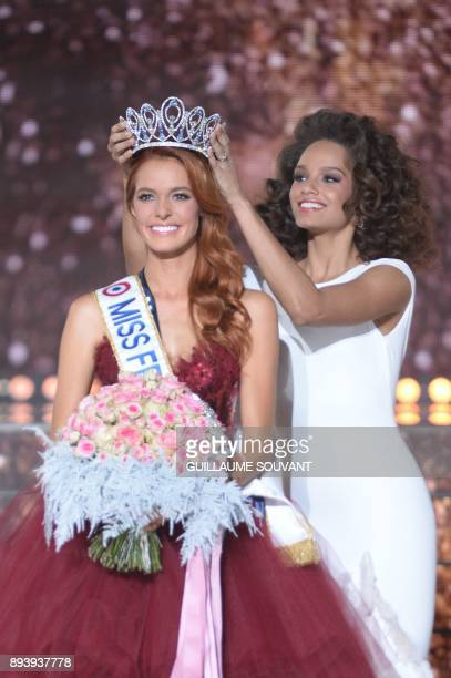 Miss NordPasdeCalais Maeva Coucke is crowned by Miss France 2017 Alicia Aylies after winning the Miss France 2018 pageant in Chateauroux central...