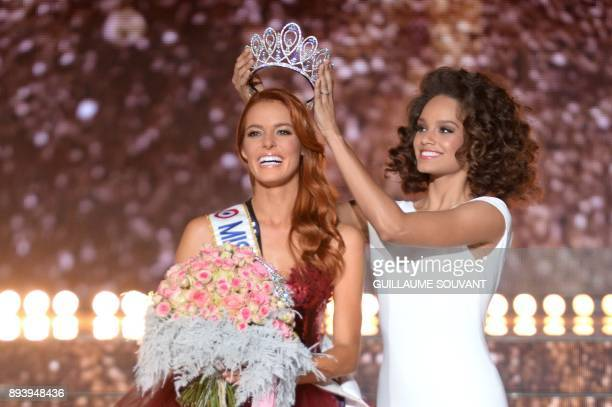 TOPSHOT Miss NordPasdeCalais Maeva Coucke is crowned by Miss France 2017 Alicia Aylies after winning the Miss France 2018 pageant in Chateauroux...