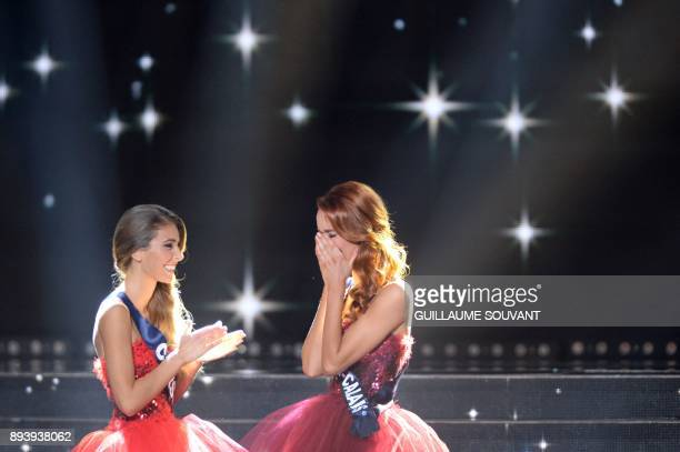 Miss NordPasdeCalais Maeva Coucke reacts next to first runner up Miss Corsica Eva Colas after winning the Miss France 2018 pageant in Chateauroux...