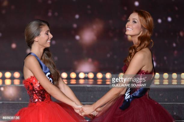 Miss NordPasdeCalais Maeva Coucke reacts with Miss Corsica Eva Colas during the announcement of the winner of the Miss France 2018 pageant in...