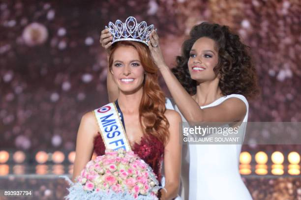 Miss NordPasdeCalais Maëva Coucke is crowned by Miss France 2017 Alicia Aylies after winning the Miss France 2018 pageant in Chateauroux central...