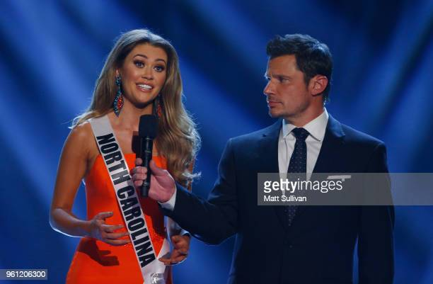 Miss North Carolina Caelynn MillersKeyes answers a question with host Nick Lachey during the 2018 Miss USA Competition at George's Pond at Hirsch...