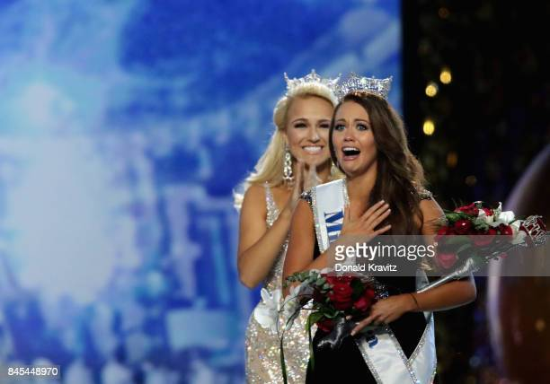 Miss North Dakota 2017 Cara Mund is crowned as Miss America 2018 by Miss America 2017 Savvy Shields during the 2018 Miss America Competition Show at...