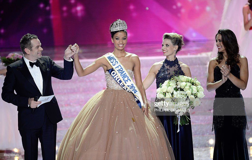 Miss Orleans Flora Coquerel (2nd L) reacts next to Canadian singer and jury president Garou (L), Miss France Society president Sylvie Tellier (2nd R) and Miss France 20123 Marine Lorphelin (R) after being crowned Miss France 2014 during the 67th edition of the beauty contest in the northeastern city of Dijon on December 7, 2013.