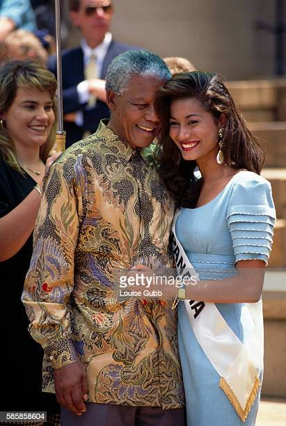Miss Panama a contestant in the Miss World beauty pageant is overcome upon meeting an equally speechless President Nelson Mandela President of South...