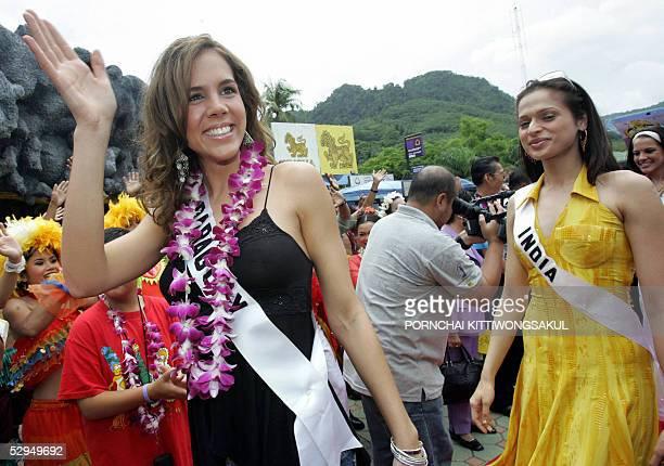 Miss Paraguay Universe 2005 Karina Buttner poses for a photo as she arrives with Miss India Universe 2005 Amrita Thapar at Phuket Fantasea theme park...