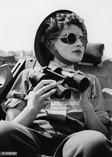 Miss Parker a member of the Auxiliary Territorial Service on duty as an enemy aircraft spotter near London 1943 | Location near London England UK