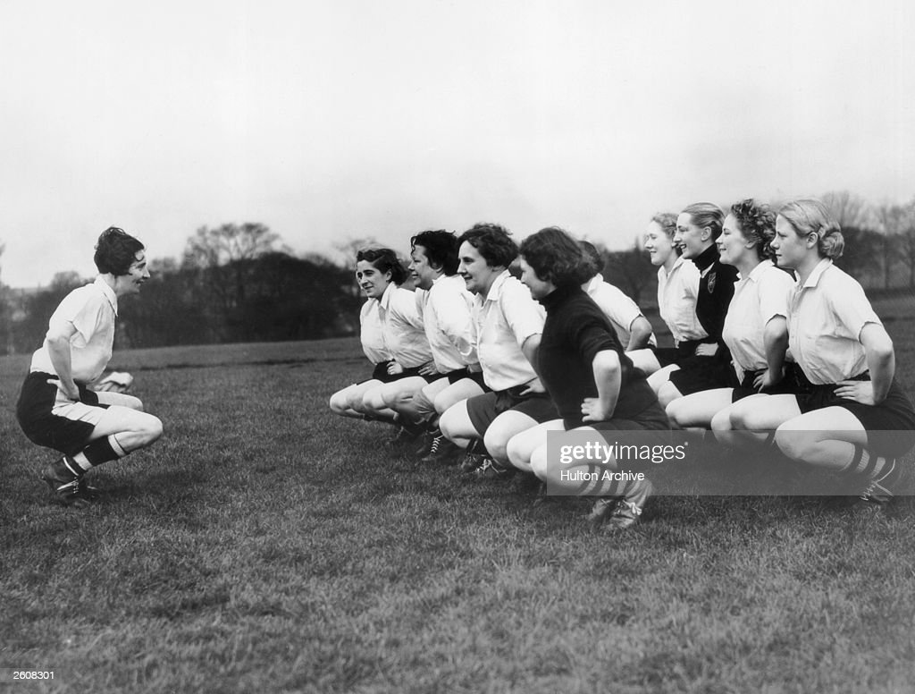 Miss Parr, captain of the Preston Ladies Football Club leads her team in their excercises.