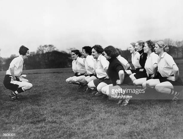 Miss Parr captain of the Preston Ladies Football Club leads her team in their excercises
