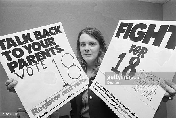 Miss Patricia Keefer at her office 3/8 She is holding up placards urging 18 years olds to use their power and vote