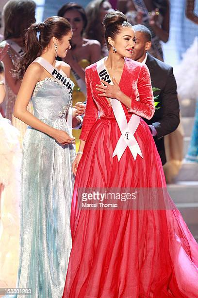 Miss Philippines 2012 Janine Tugonon and Miss USA 2012 Olivia Culpo and react during the 2012 Miss Universe Pageant at Planet Hollywood Resort &...