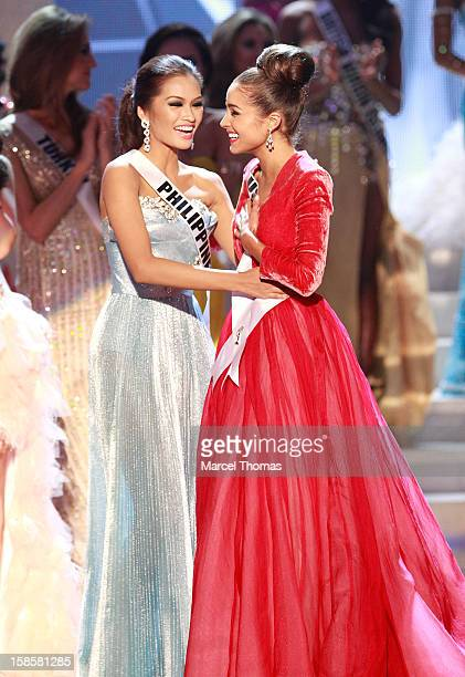 Miss Philippines 2012 Janine Tugonon and Miss USA 2012 Olivia Culpo and react during the 2012 Miss Universe Pageant at Planet Hollywood Resort Casino...