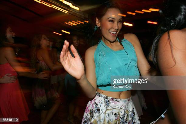 Miss Philippines Carlene Aguilar and other contestants of the 55th Miss World 2005 dance during a party after the Beachwear Final at the Sheraton...