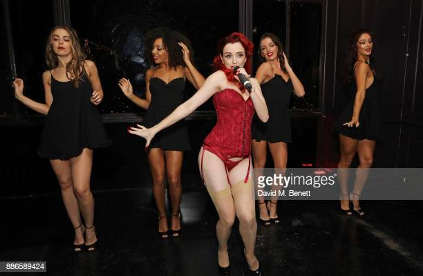 Miss Polly Rae performs at the launch of Pamela Anderson's exclusive Coco De Mer collection at Morton's on December 5 2017 in London England