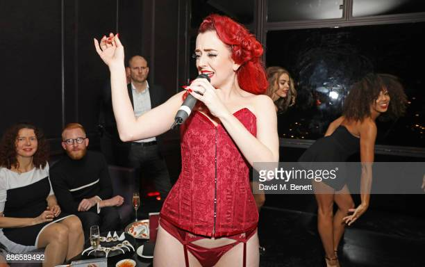 Miss Polly Rae performs at the launch of Pamela Anderson's exclusive Coco De Mer collection at Morton's on December 5, 2017 in London, England.