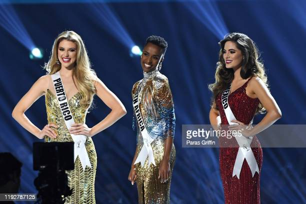 Miss Puerto Rico Madison Anderson Miss Universe 2019 Zozibini Tunzi of South Africa and Miss Mexico Sofía Aragón appear onstage at the 2019 Miss...
