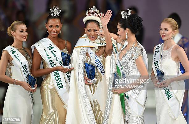 Miss Puerto Rico Valerie Hernandez Matias is congratulated by 3rd runner-up Miss United Kingdom Victoria Charlotte Tooby, runner-up Miss Colombia...