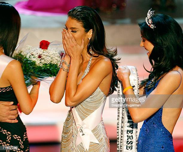 Miss Puerto Zuleyka Rivera Mendoza is crowned Miss Universe by Miss Universe 2005 Natalie Glebova during the Miss Universe 2006 pageant at the Shrine...
