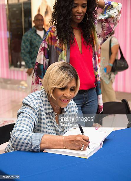 Miss Robbie signs her book Sweetie Pie's Cookbook Soul Southern Recipes From My Family To Yours at the Leimert Park Village Book Fair at Baldwin...