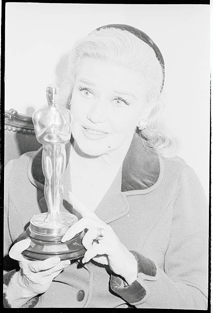 Miss Rogers holds her prized Academy Award Oscar which she won for her performance in the film Kitty Foyle