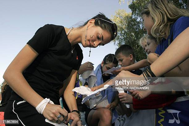 Miss Romania Ioana Valentina Boitor gives autographs to the audience after Miss Sport competition in Mazurian lakes region city of Gizycko 12...