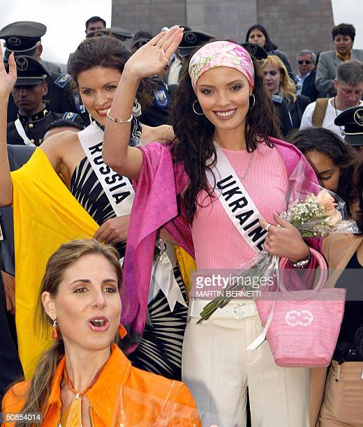 Miss Russia Kseniya Kustova Miss Ukraine Oleksandra Nikolayenko and Miss Panama Jessica Rodriguez wave in front of the Middle of the World monument...