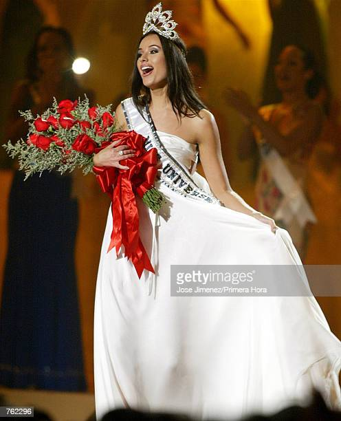 Miss Russia Oxana Fedorova reacts as she is named Miss Universe during the 51st Annual Miss Universe competition at the Roberto Clemente Coliseum May...
