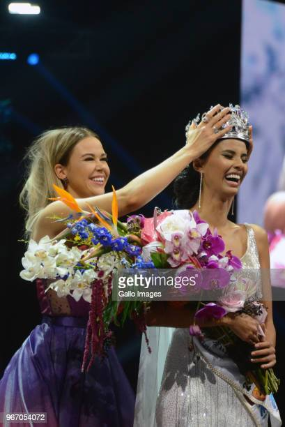 Miss SA 2017 Adé van Heerden hand over the crown to new Miss SA 2018 Tamaryn Green during the Miss SA 2018 beauty pageant grand finale at the Time...