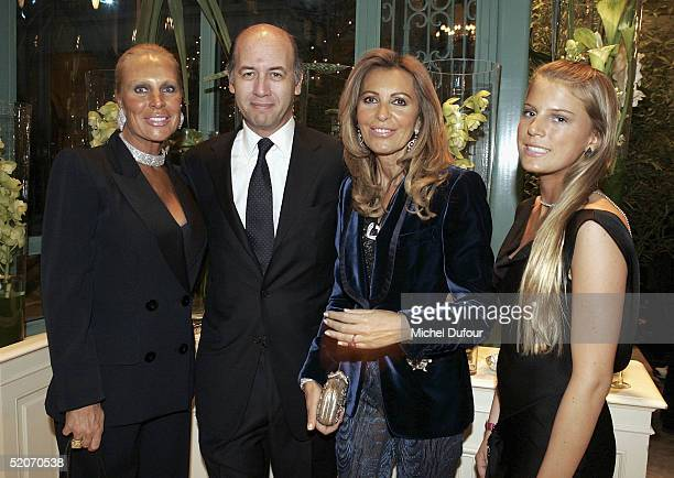 Miss Saperstein and her daughter poses with Serge Weinberg and his wife at the Chopard Party at the Intercontinental Hotel as part of Paris Fashion...