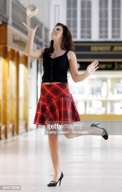 Miss Scotland Nieve Jennings tossing a haggis near Sloans Bar and Restaurant in Glasgow ahead of Burns Night
