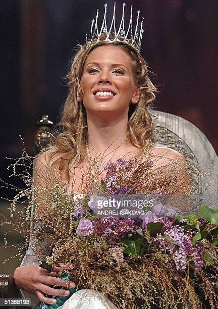 Miss Serbia and Montenegro for the year 2004 Jelena Pejic poses for photographers after winning the contest in Belgrade 04 October 2004 AFP PHOTO/...