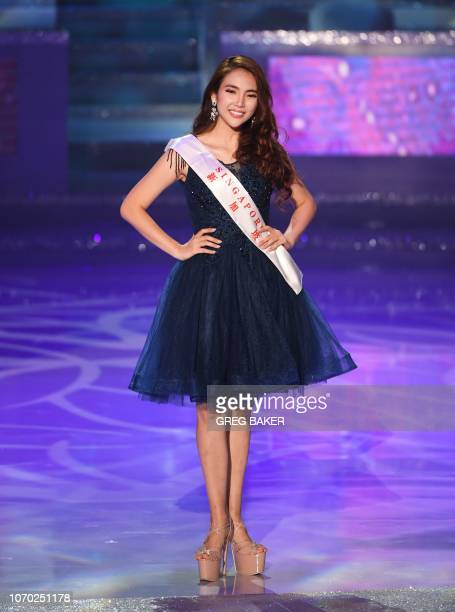 Miss Singapore Vanessa Peh walks on stage during the 68th Miss World contest final in Sanya on the tropical Chinese island of Hainan on December 8...