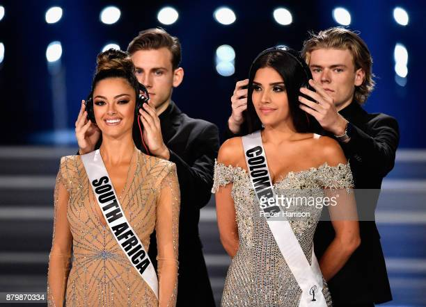 Miss South Africa 2017 DemiLeigh NelPeters and Miss Colombia 2017 Laura Gonzalez compete during the interview portion of the 2017 Miss Universe...