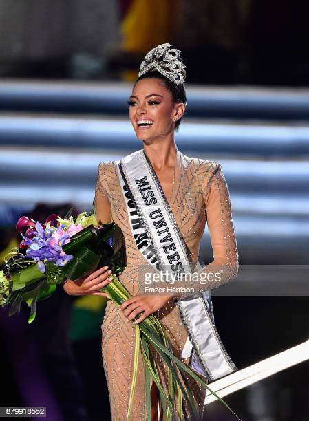 Miss South Africa 2017 DemiLeigh NelPeters reacts after being named the 2017 Miss Universe during the 2017 Miss Universe Pageant at The Axis at...
