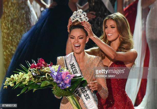 Miss South Africa 2017 DemiLeigh NelPeters reacts as she is crowned new Miss Universe 2017 by Miss Universe 2016 Iris Mittenaere November 26 2017 in...