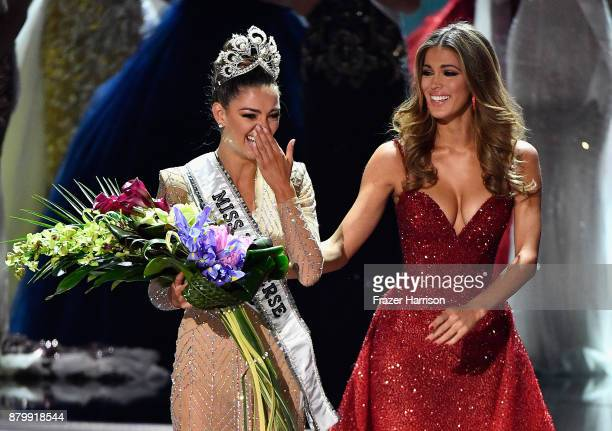 Miss South Africa 2017 DemiLeigh NelPeters reacts as she is crowned the new Miss Universe 2017 by Miss Universe 2016 Iris Mittenaere during the 2017...