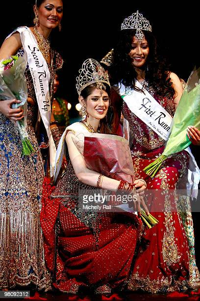 Miss South Africa Kajal Luthchminarain is crowned Winner of the Miss India Worldwide 2010 flanked by Miss Suriname Cher Marchand second Princess and...