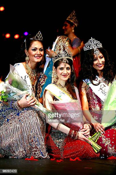 Miss South Africa Kajal Luthminarain is crowned Winner of the Miss India Worldwide 2010 flanked by Miss Suriname Cher Marchand second Princess and...
