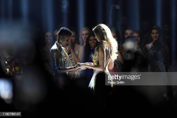 Miss South Africa Zozibini Tunzi and Miss Puerto Rico Madison Anderson await the final decision at the 2019 Miss Universe Pageant at Tyler Perry...