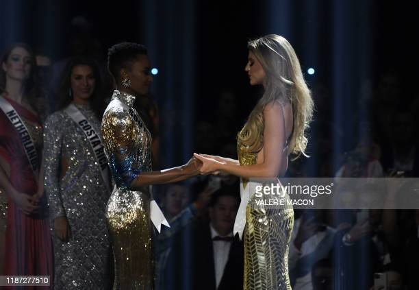 Miss South Africa Zozibini Tunzi and Miss Puerto Rico Madison Anderson the two finalists wait to hear the winner's name on stage during the 2019 Miss...
