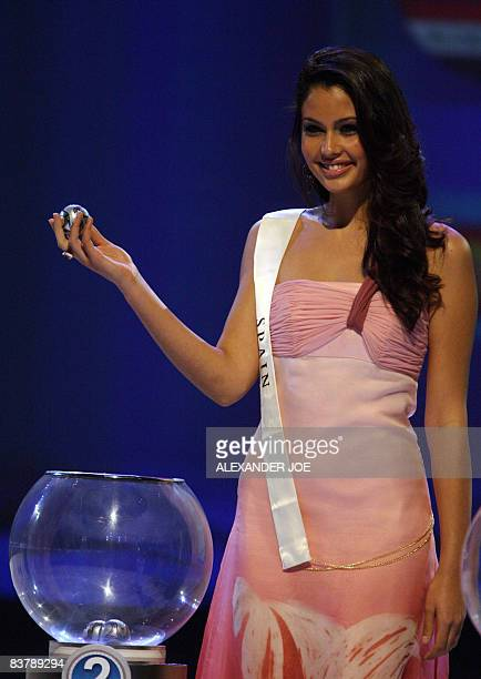 Miss Spain Patricia Yurena Rodriguez Alonjo picks a ball with the name of a team during the Final Confederations Cup draw at Sandton Covention Centre...
