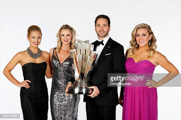 Miss Sprint Brooke Werner Kim Coon and Jaclyn Roney pose with NASCAR Sprint Cup Series Champion Jimmie Johnson pose for a portrait prior to the...