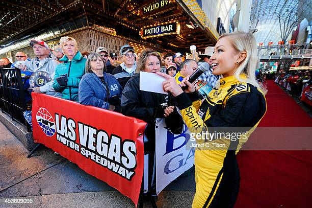 Miss Sprint Cup Brooke Werner attends a fanfest hosted by Las Vegas Motor Speedway on the Third Street Stage at the Fremont Street Experience on...