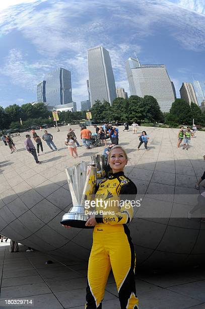 Miss Sprint Cup Brooke Werner holds the Sprint Cup Trophy as she stands next to The Cloud Gate in Millennium Park on September 11 2013 in Chicago...