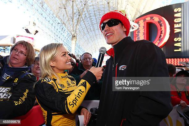 Miss Sprint Cup Brooke Werner interviews Sprint Cup Series driver Joey Logano at a fanfest hosted by Las Vegas Motor Speedway on the Third Street...